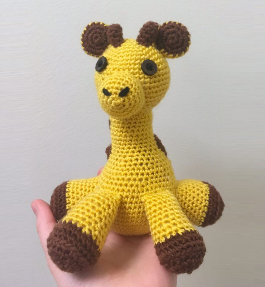 A crocheted yellow giraffe