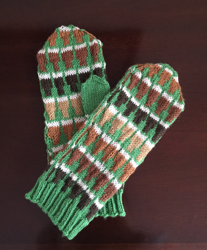 Knitted mittens in shades of brown and green