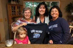 Carol McDevitt '74, Catherine O'Brien '03, Lina Cashin '88 and the granddaughter of Carol McDevitt in Bellevue, NE.