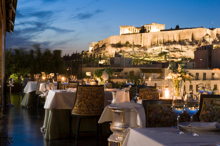 Royal Olympic Hotel roof garden by night with view of the Acropolis