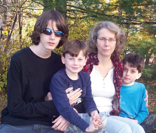 Kathryn Gandek-Tighe '84 and children (from left) Greg, 14; twins Eric and Chris, 9