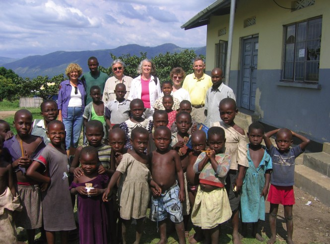"Deborah Walker, shown here (back row, center) visiting a clinic in Uganda, says she's in public health because it is ""the practice of social justice."""