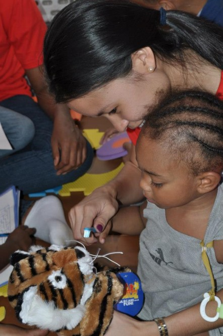 Laurian Lue Yen '10 demonstrates proper tooth-brushing technique