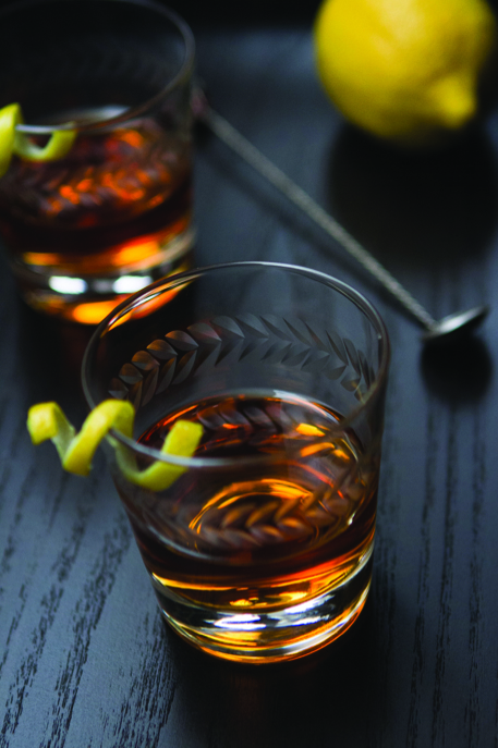 The Sazerac is a local New Orleans drink, composed of cognac or rye whiskey, absinthe or Herbsaint, and Peychaud's Bitters.