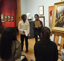 Premed students discuss a nineteenth-century painting