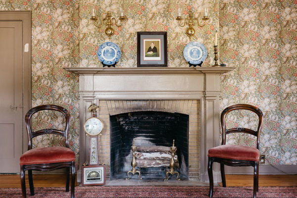 Fireplace and two chairs at Sycamores