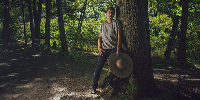 Professor Lauret Savoy in the woods near Upper Lake on the Mount Holyoke campus.