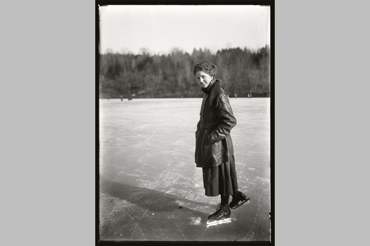 Mary Gorham, class of 1921, skates on one of the campus lakes.
