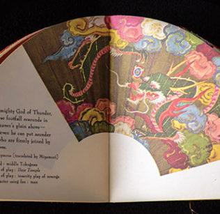 Open fan book, shaped like a half circle