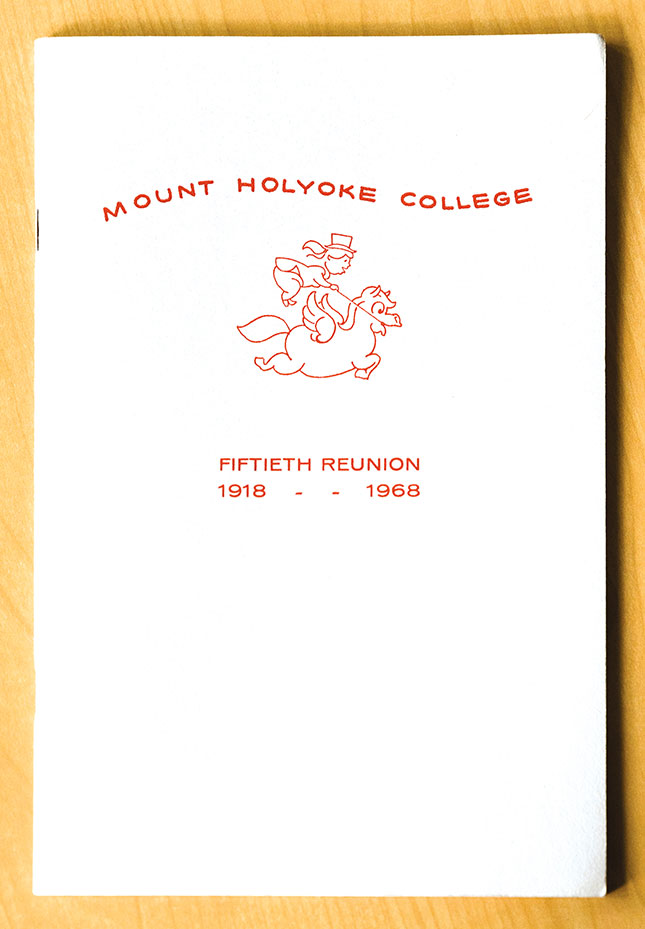Cover of 50th reunion booklet with bouncing hatted rider