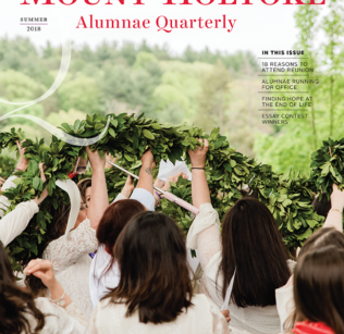 Cover of Summer Quarterly with graduates raising the laurel chain