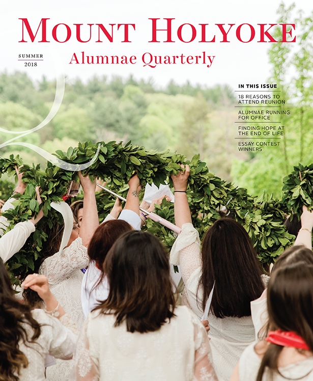 Cover of Summer Quarterly with graduates raising the laurel chain