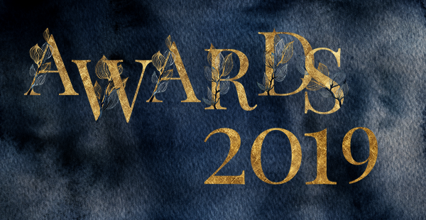"Gilded text reads ""Awards 2019"" over a dark blue cloudy metallic background."