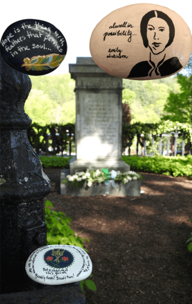 "Several rocks: one rock is painted eggshell white with a sketch of Emily Dickinson and reads, ""dwell in possibility...""; another is painted black with a feather and reads, ""Hope is the thing with feathers that perches in the soul""; the third, placed near Mary Lyon's grave, has the lyrics of ""Bread and Roses."""