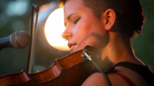 Zoe Darrow plays her Celtic fiddle.