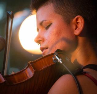 Zoe Darrow plays her Celtic fiddle.