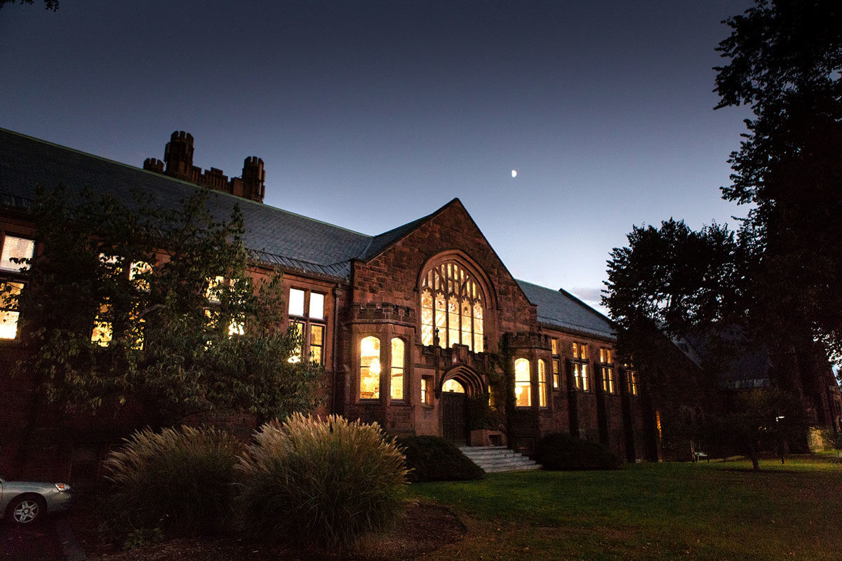 The library as seen at night from outside on College Street.